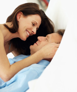 Happy mature couple having a seductive moment in bed